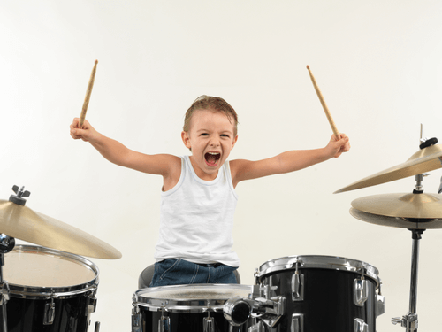 a boy behind a drum set