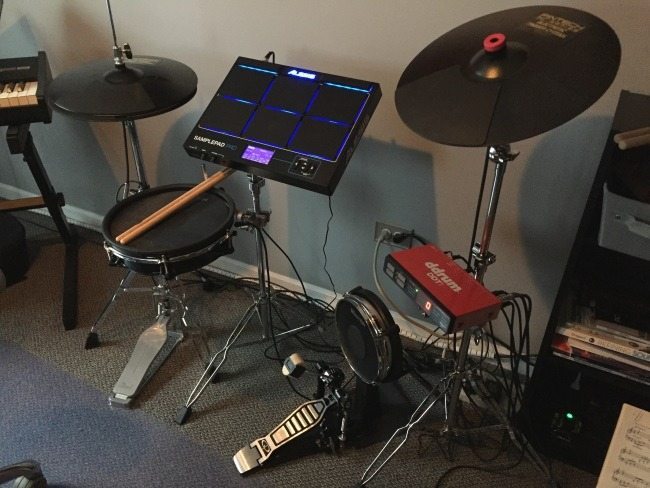 electronic drum pad setup, with bass pedals, electronic cymbals, amp and stands