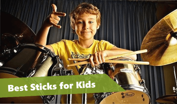 kid drum player holding a pair of drum sticks