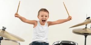 a boy behind a drum set