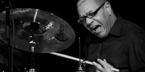 Ignacio Berroa playing on the drums, black and white picture