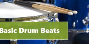 """drum with 2 sticks on the head, it is header image of the article """"Basic Drum Beats"""""""