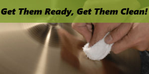 hand holding cloth cleaning cymbal with polisher or cleaner