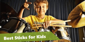kid drum player holding a pair of drum sticks
